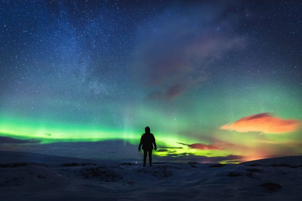 Explosions of colour fill the sky as the northern lights dance above a snow drenched Icelandic landscape.