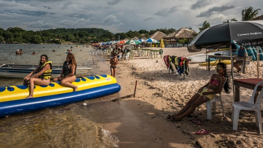 Beachgoers relax and enjoy the amenities along the Tapajos River in Alter Do Chao.