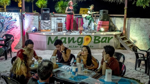 Musicians at Mango Bar, where patrons can enjoy drinks made with local fruits, in Alter Do Chao.