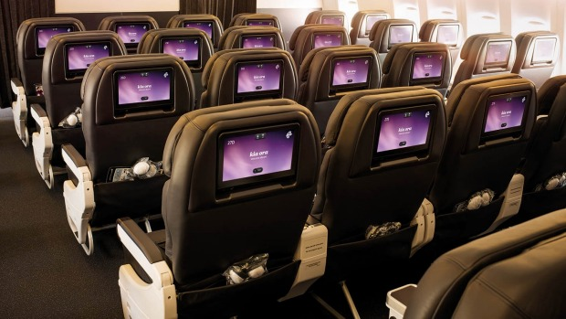 Premium economy seating features universal power and USB points.