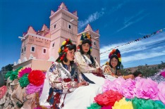 Girls in traditional costume on a float at the Rose Festival, Morocco.