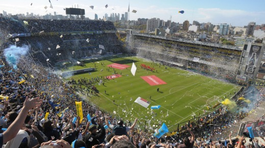 Boca Juniors fans cheer prior to an Argentine soccer league game against River Plate at La Bombonera stadium in Buenos Aires.