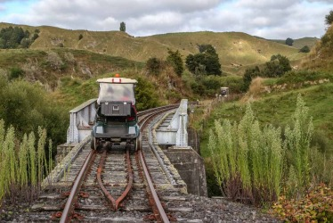 "Traveling along the ""Forgotten Railway"" from Taumarunui in converted golf carts in the North island of New Zealand."