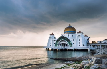 Malacca Straits Mosque in Malaysia. This image was taken on 9th of March 2017 in the Malaysian city of Malacca which is ...