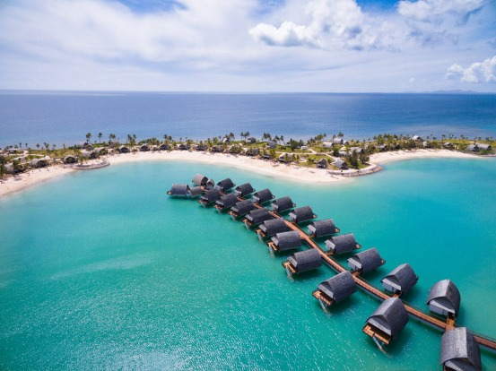 Fiji Marriott Resort Momi Bay: Across a sandy, palm fringed beach is a now sparkling lagoon where 22 luxurious (adults ...