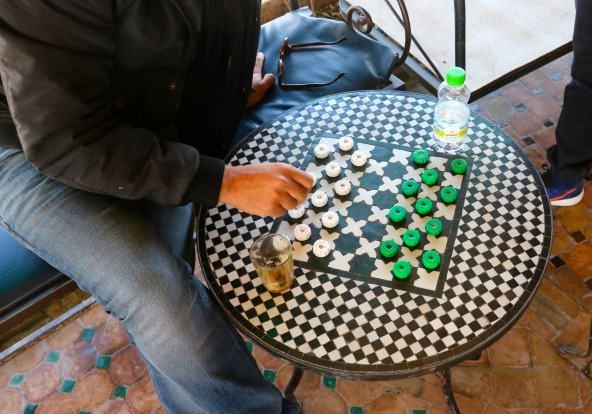 Our guide Khalid Llamlih playing Moroccan checkers.