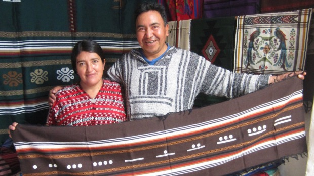 Miguel and Racquel Hernandez with Miguel's hand woven crafts.