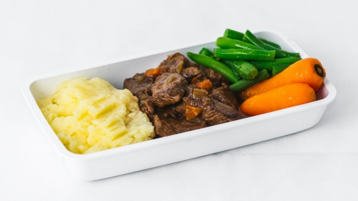 Cooper's Pale Ale braised Black Angus beef, seasonal vegetables and garlic mash, served on premium and economy class flights.