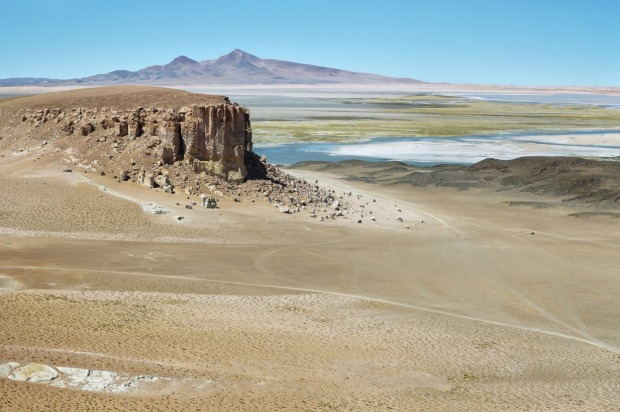 View of Chilean high plateau desert with Salar de Tara at background.