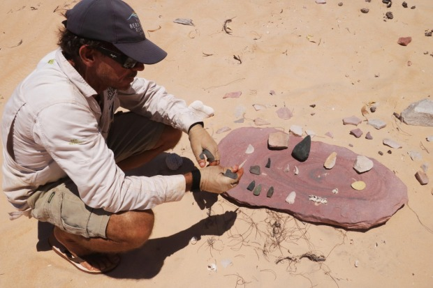 Guide Bruce Maycock with Indigenous stone tools.