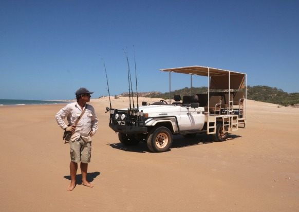 Guide Bruce Maycock with a safari vehicle.