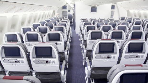 American Airlines Boeing 777-300ER interior, economy class cabin.