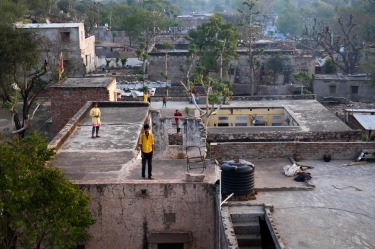 During a hot air balloon flight near Jaipur, India, villagers stood on the roofs of their homes to see our hot air ...