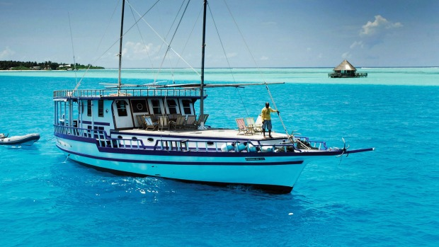 Swim, snorkel and sail aboard a dhoni in the Maldives with World Expeditions.