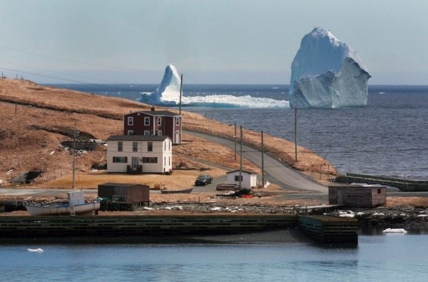 The large iceberg is visible from the shore in Ferryland, an hour south of St. John's, Newfoundland . More icebergs have ...