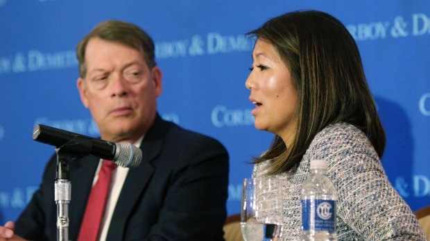 Crystal Pepper,  accompanied by attorney Stephen Golan, speaks at a news conference on Thursday.