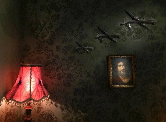 Art displayed on the wall at The Walled Off Hotel.