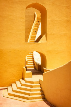 Architectural detail photo of the Jantar Mantar monument in Jaipur, Rajasthan, India. It is a collection of nineteen ...