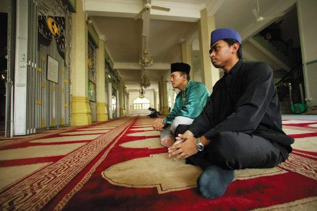 Prayer time in the Sultan Mosque, Singapore.