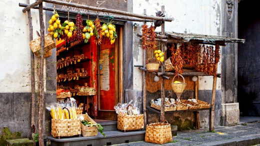 Fresh produce and pasta for sale on a street in Sorrento.