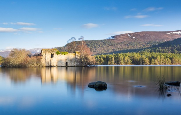 Loch an Eilein, with the remains of 13th Century castle, in the Cairngorm National Park, Scotland.