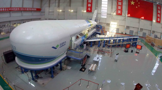 "The ""iron bird"" test platform, a plane-like fuselage simulator, for China's first home-made jet the C919."