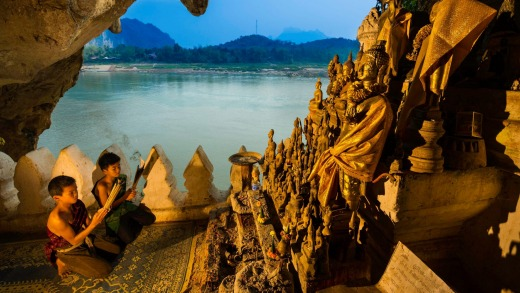 Pak Ou caves with 2500 buddha statues in Luang Prabang province, Laos.