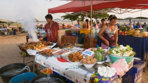 Food stalls on side of Mekong River, Vientiane, Laos.