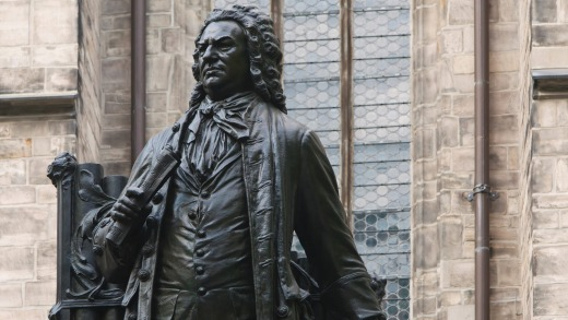A statue of Johann Sebastian Bach Statue in front of St Thomas's Church, Leipzig, Germany.