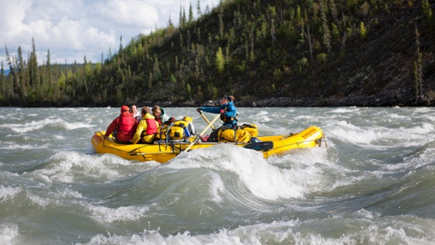 Rafting the rapids of the South Nahanni River.