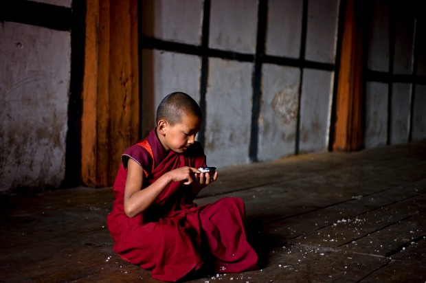 A young monk and his rice bowl.