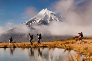 Hikers make their way under Taranaki.