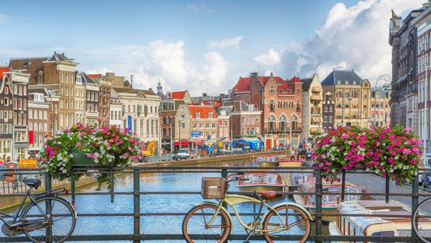 See Amsterdam by bike or boat.