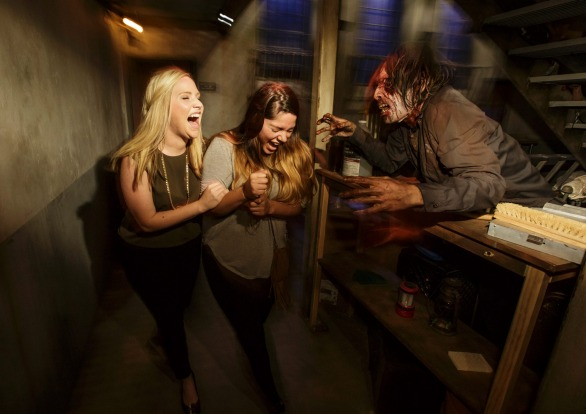 Brace yourself for zombies appearing from out of nowhere in the Walking Dead maze.