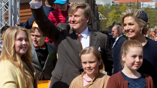 Dutch King Willem-Alexander greets well-wishers as he poses with his wife Queen Maxima, and their children Princesses ...