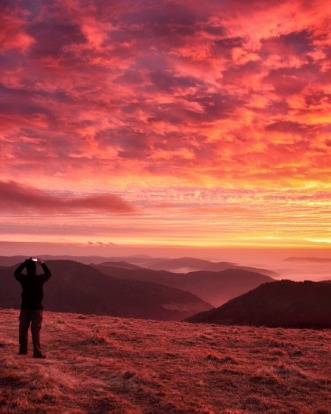 Black Forest, Germany. View from Mt Felburg. Winter sunset with freezing fog in the valley trapping the unbelievable ...