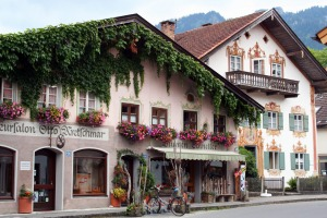 Traditional alpine buildings with frescoes.