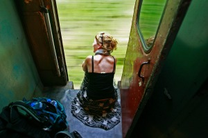 A tourist looks out the train on the way to Galle.