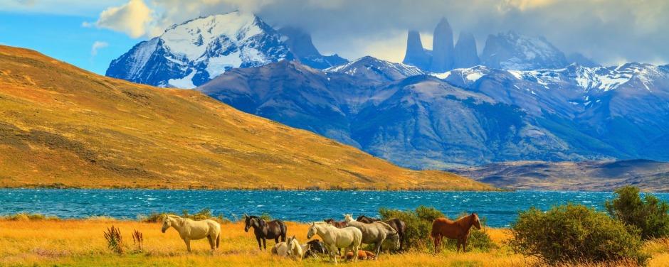 The Torres del Paine is visible among the clouds in Chile.
