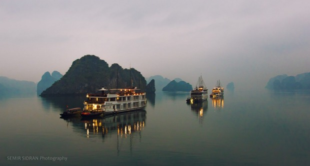 Calm waters of Halong Bay, Taken from the deck of the boat in the early morning.