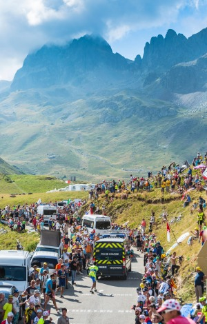 Specific vehicles which end each stage during Tour de France, driving on the road to Col du Glandon in Alps.