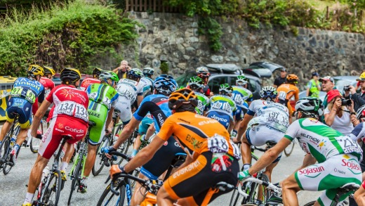 The peloton climbing the road to Alpe-D'Huez.