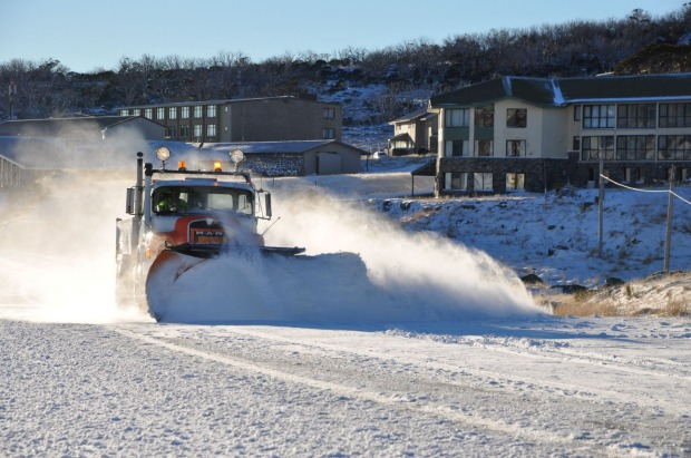 A snow plow clearing the road at Perisher Ski Resort.