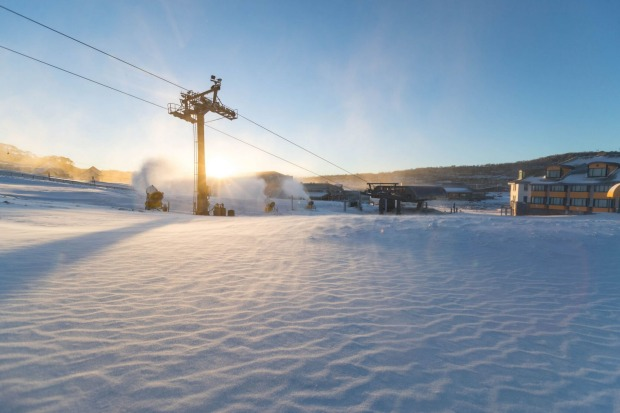Chairlift and snow covered lodge at Perisher Ski Resort.