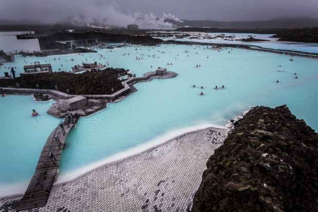 People relaxing and bathing in the stunning Geothermal Area of the Blue Lagoon, near Reykjavik, Iceland.
