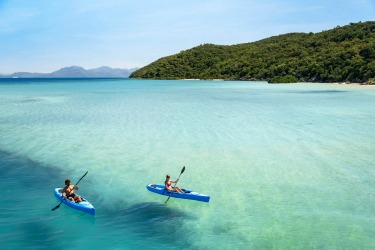 Kayaking over the azure waters of Hazard Bay, Orpheus Island. 110 km north of Townsville in the Coral Sea, this secluded ...