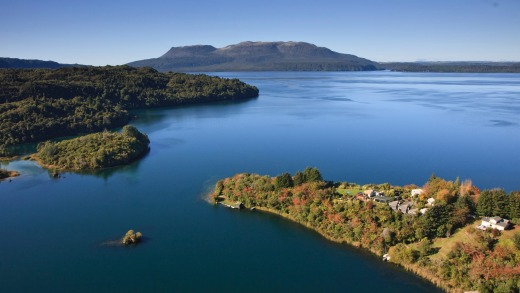 Lake Tarawera, the many bays, the mountain and the surrounding richly vegetated green hills all give a strong hint at ...