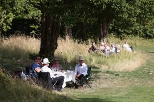 Audience members picnic in the grounds of Glyndebourne opera house in Lewes, England.