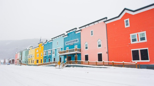 Colourful buildings contrast with the snowy landscape in Dawson City.
