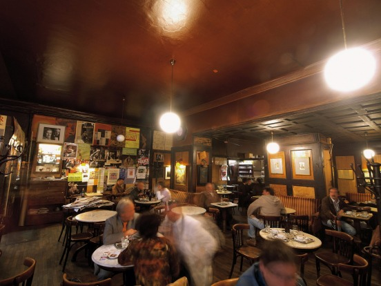 Café Hawelka is old Vienna, retaining its 1930s look so that you feel you've strayed into the movie set of a film noir. ...